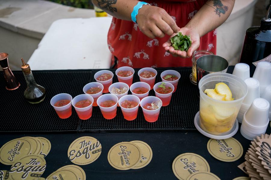 Esquire Tavern's Zulcoralis Rodríguez prepares a drink. Photo by Kathryn Boyd-Batstone