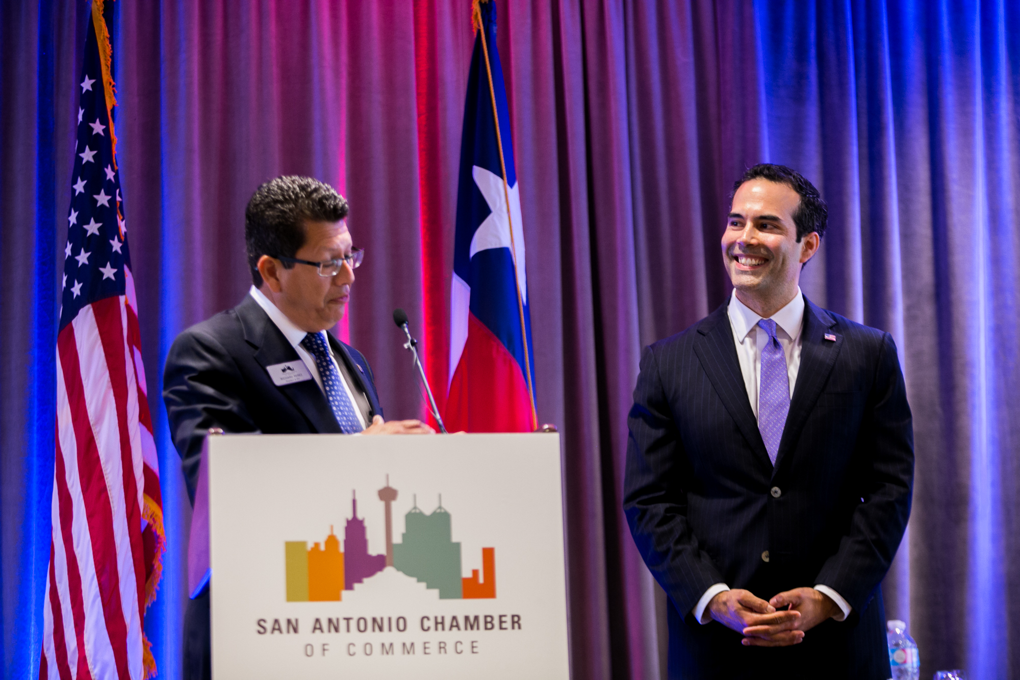 President and CEO of the San Antonio Chamber of Commerce Richard Perez thanks Texas Land Commissioner George P. Bush for his help in the preservation and redevelopment of The Alamo. Photo by Kathryn Boyd-Batstone