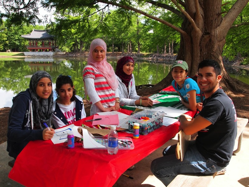Teens hang out at a craft table during the 2014 Celebrate Spring event. Photo by Sheena Maria Connell.