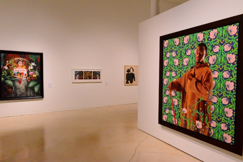 """""""David Lyon"""" (2013) by Kehinde Wiley (r). Works by Morimura, Julien and Katz (l-r). Photo by Page Graham."""