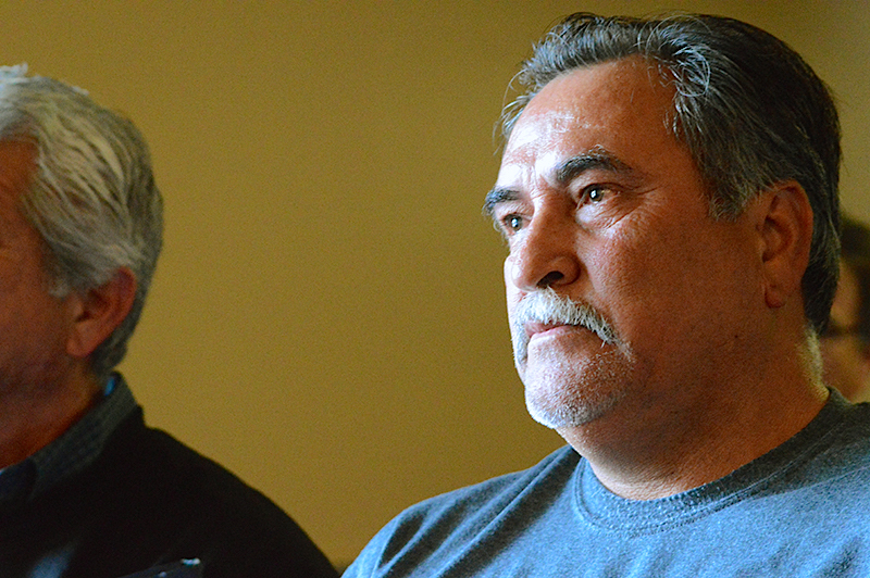 Fernando Gutierrez, a longtime Highland Oaks resident, was visibly moved by the Bexar County Commissioners' vote to find funding to repair the community's unpaved roads. Photo by Lea Thompson.