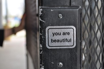 A sticker found on one of the exists to Haven for Hope's campus. Photo by Iris Dimmick.