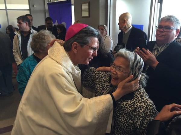 Archbishop Gustavo García-Siller comforts a woman after the memorial Mass for Fr. Virgil Elizondo at St. Rose of Lima Church. Photo by Robert Rivard.