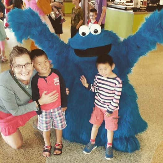 """(From left) Jill Robbins and her adopted sons, Zach and Kyle, laugh with """"Cookie Monster."""" Courtesy photo."""