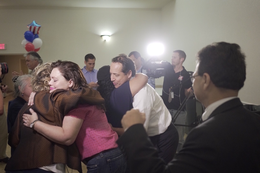 State Sen. José Menéndez reacts to early election results. Photo by Kathryn Boyd-Batstone.