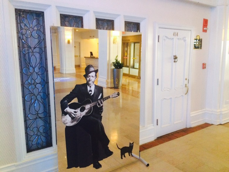 A life-size image of the iconic Robert Johnson sits in the lobby of the Sheraton Gunter Hotel.  Courtesy of Adam Tutor