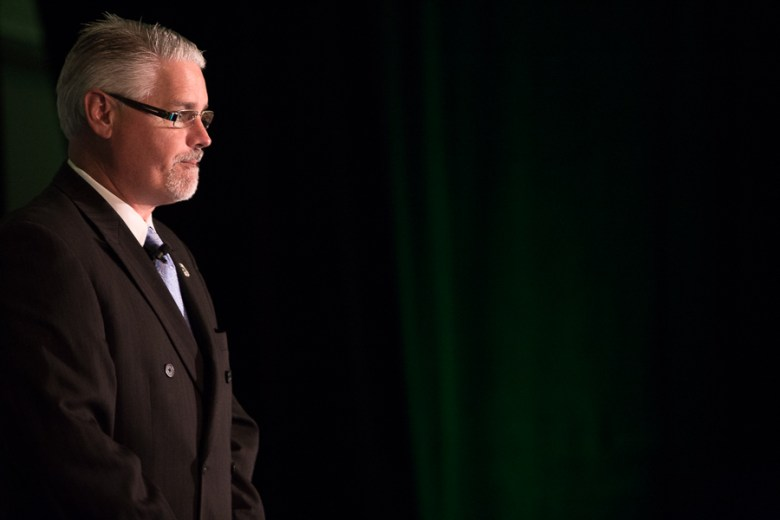 Texas State Rep. Dan Huberty (D127) stands before the audience as he is introduced. Photo by Scott Ball.