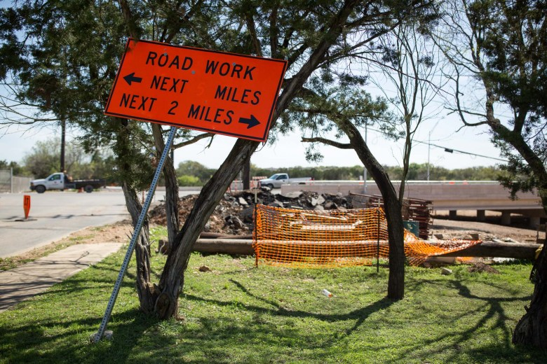 A sign displaying the amount of road work that spans Hausman Road at the intersection of Jetlyn Drive. Photo by Scott Ball.