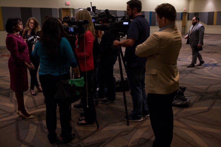 Reporters surround Mayor Taylor as she gives interviews after her United State of the City address. Photo by Scott Ball.