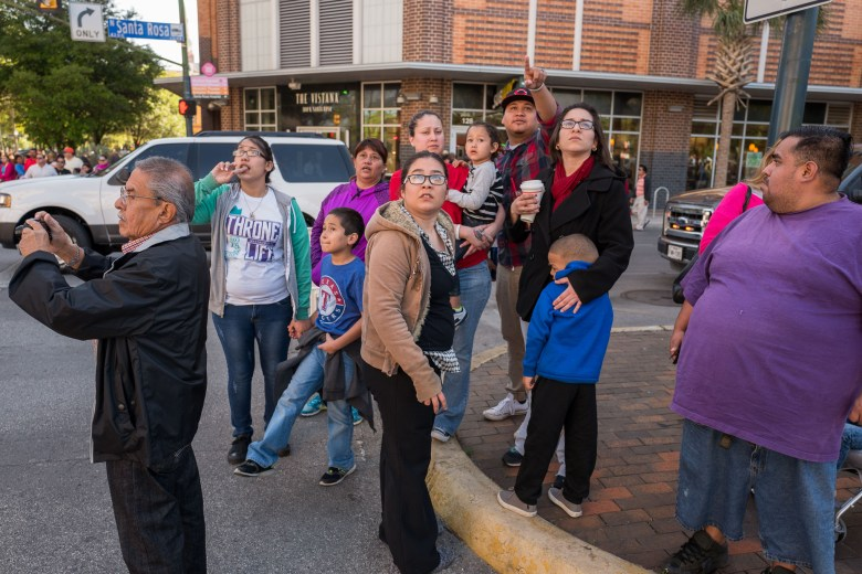 Spectators photograph the passing performance of Passion Play after a reported fire was reported at the Children's Hospital nearby. Photo by Scott Ball.
