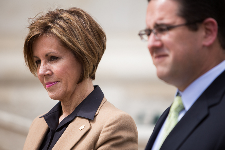 City Manager Sheryl Sculley along with Deputy City Manager Erik Walsh monitor the press conference from the side. Photo by Scott Ball.