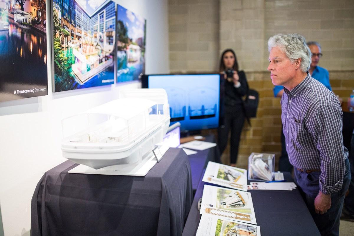 Scott Potter inspects the native San Antonian Luna Architects design proposal. Photo by Scott Ball.