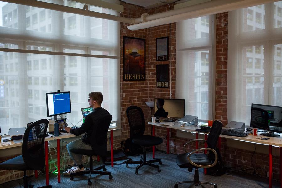 Grok Interactive Software Developer Jacob Ernst works at his desk. Photo by Scott Ball.