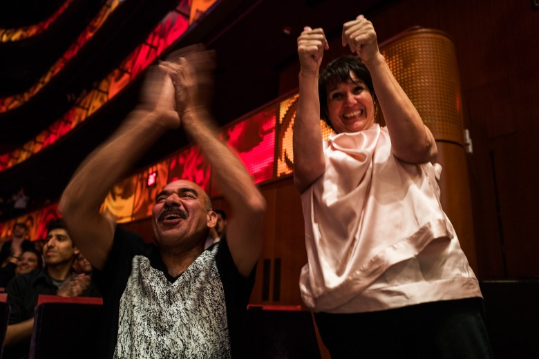 Following Alyson Alonzo's performance her parents Claudia and Alfred DeLeon cheer for her. Photo by Scott Ball.