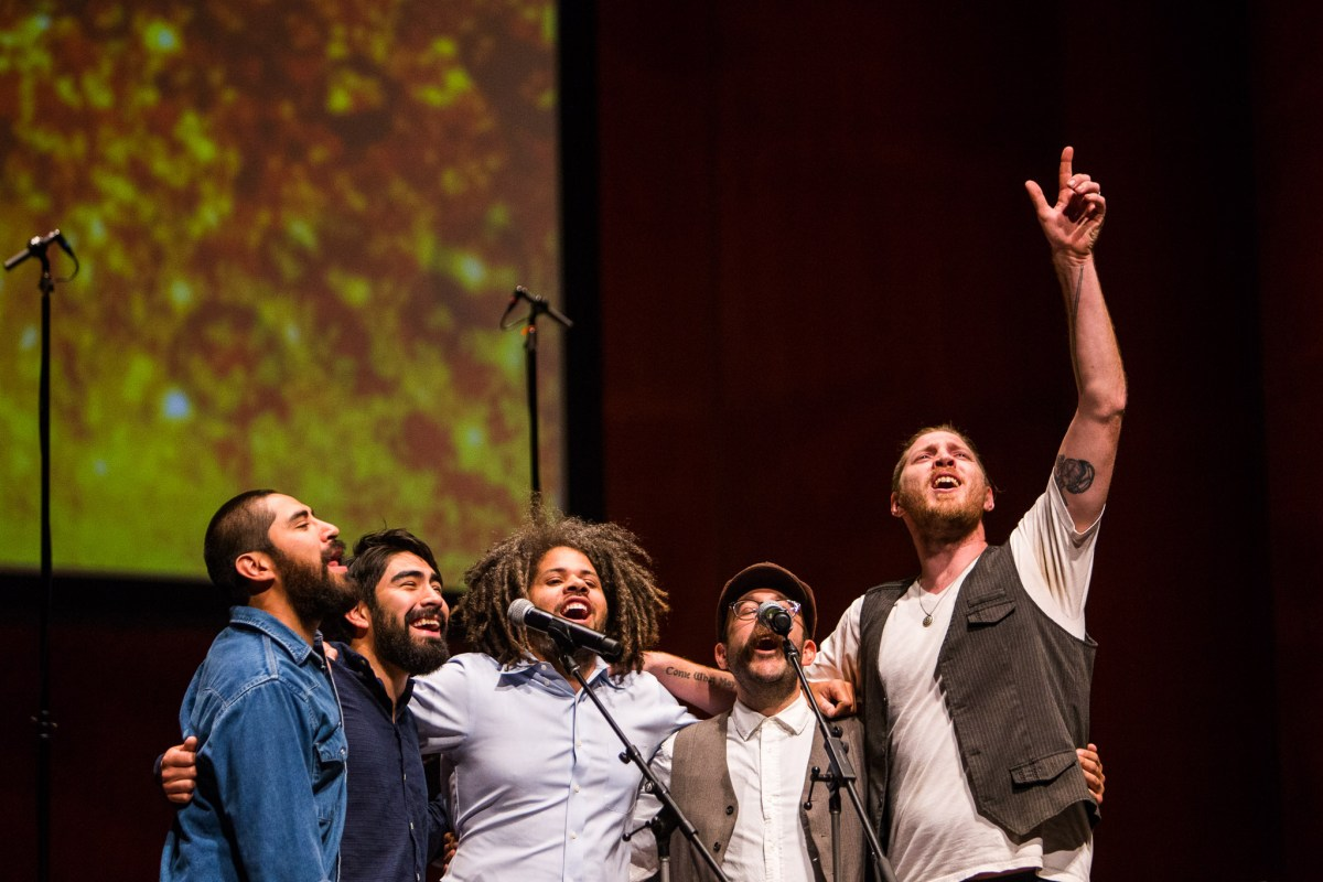 Fishermen return to the stage to sing Carry That Weight. Photo by Scott Ball.