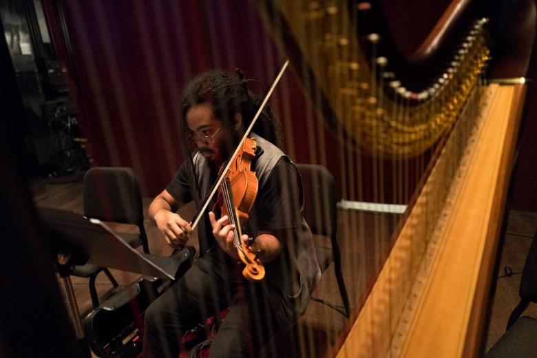 Member of YOSA and Femina-X Darian Thomas practices his instrument. Photo by Scott Ball.