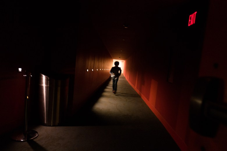 A child runs down the hallway to return to his seat. Photo by Scott Ball.