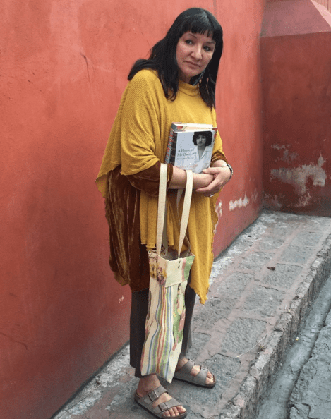 Author and poet Sandra Cisneros in a Mexican neighborhood. Photo courtesy of Sandra Cisneros ©.