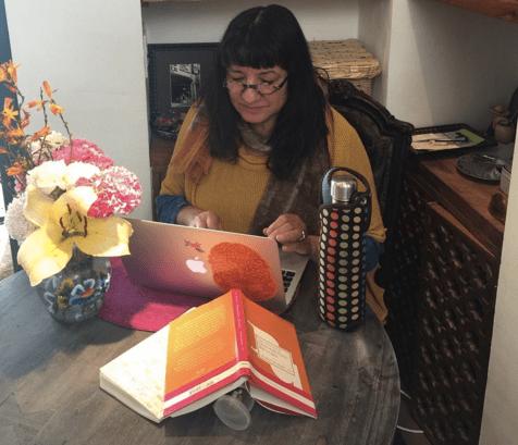 Author and poet Sandra Cisneros at work. Photo courtesy of Sandra Cisneros ©.