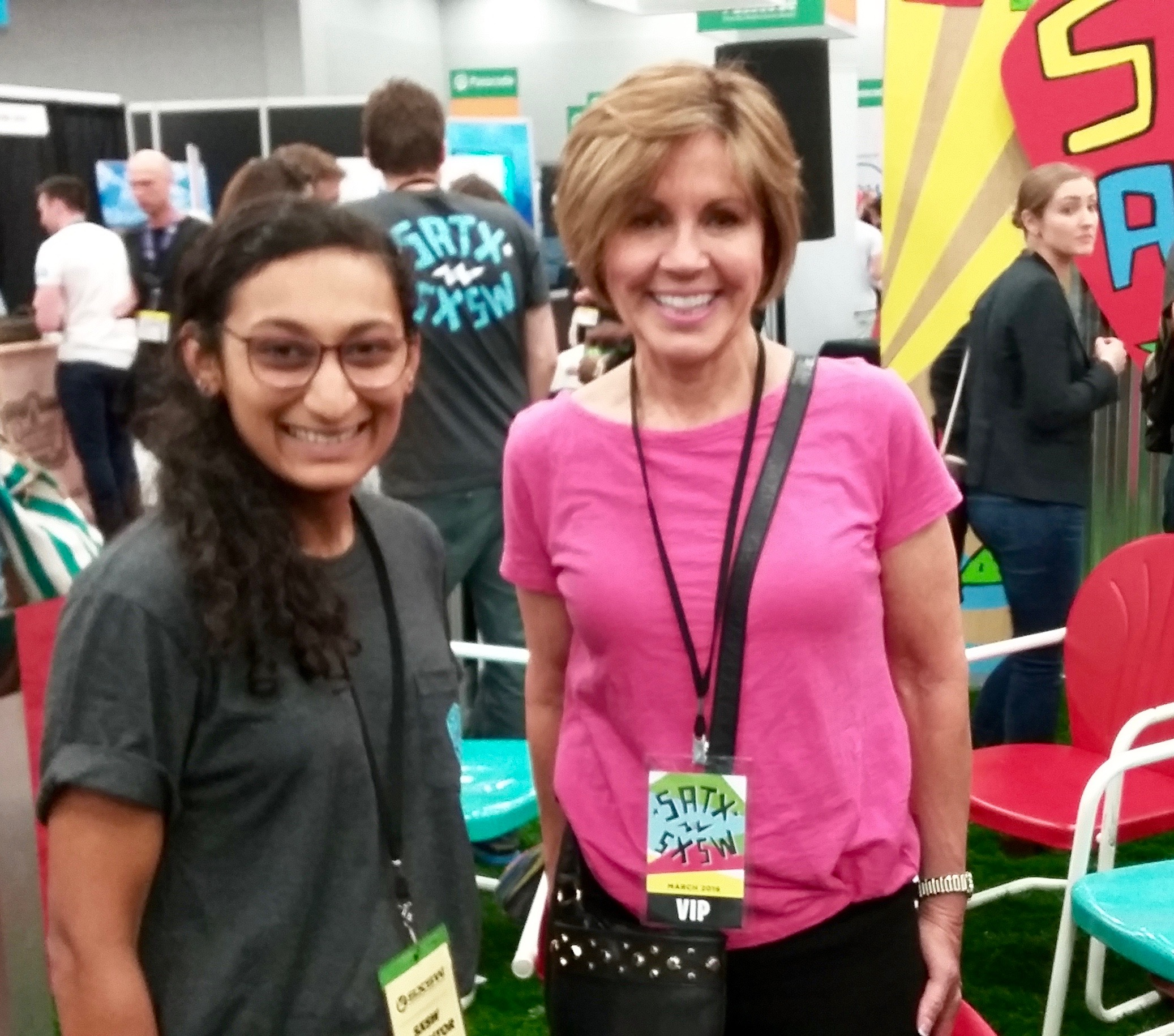 San Antonio City Manager Sheryl Sculley (right) visits the Choose San Antonio space at the South by Southwest trade show on Sunday, March 13, 2016. At left is Hetali Lodaya, a volunteer at the space. Photo by Edmond Ortiz