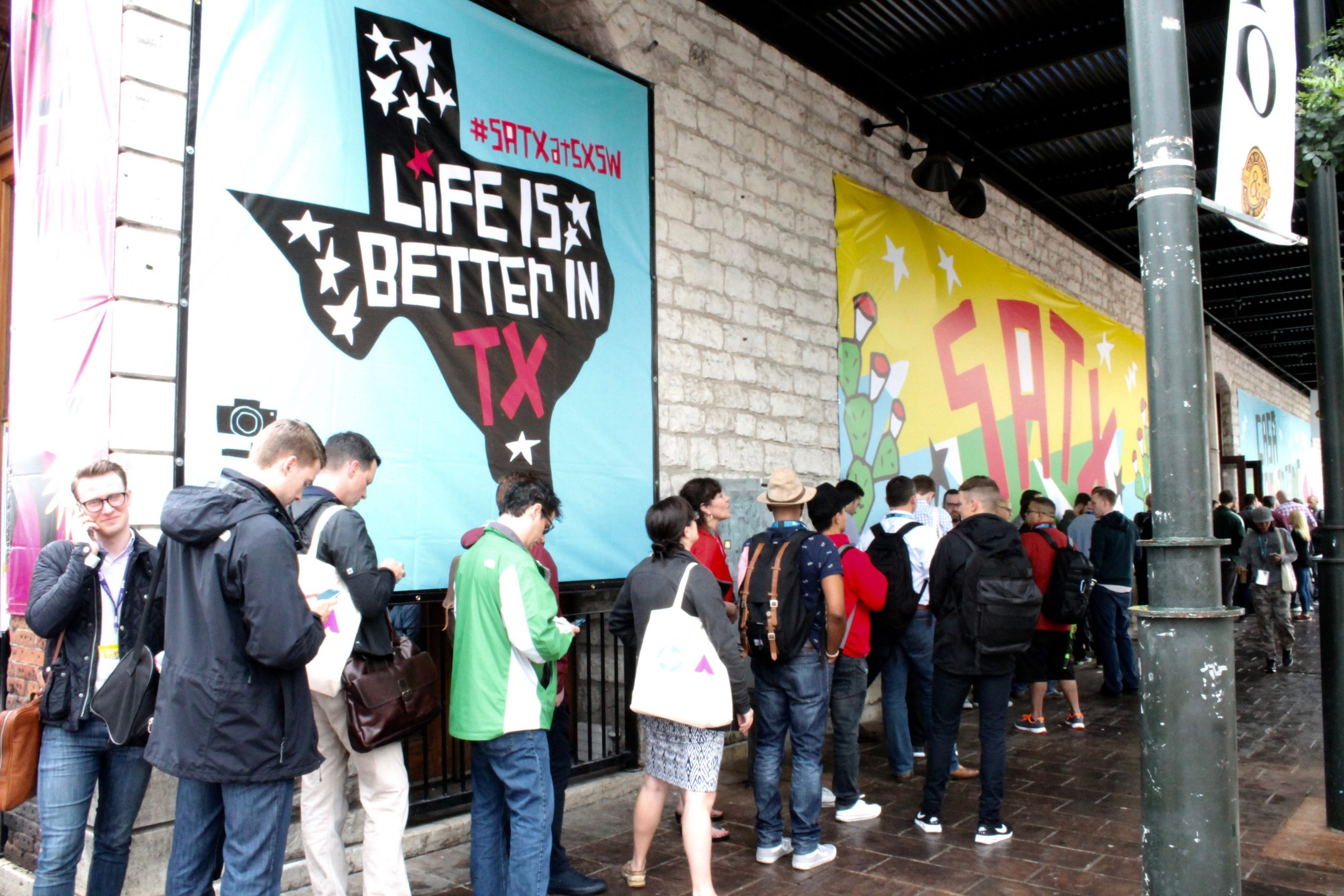 People get in line outside Austin's Old School Bar and Grill, aka Casa San Antonio, for a panel discussion on sports franchise branding in the digital age on Friday, March 11, 2016. Photo by Edmond Ortiz