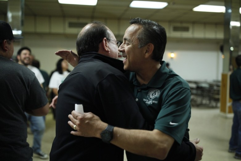 State Sen. Carlos Uresti embraces a supporter. Photo by Scott Ball.