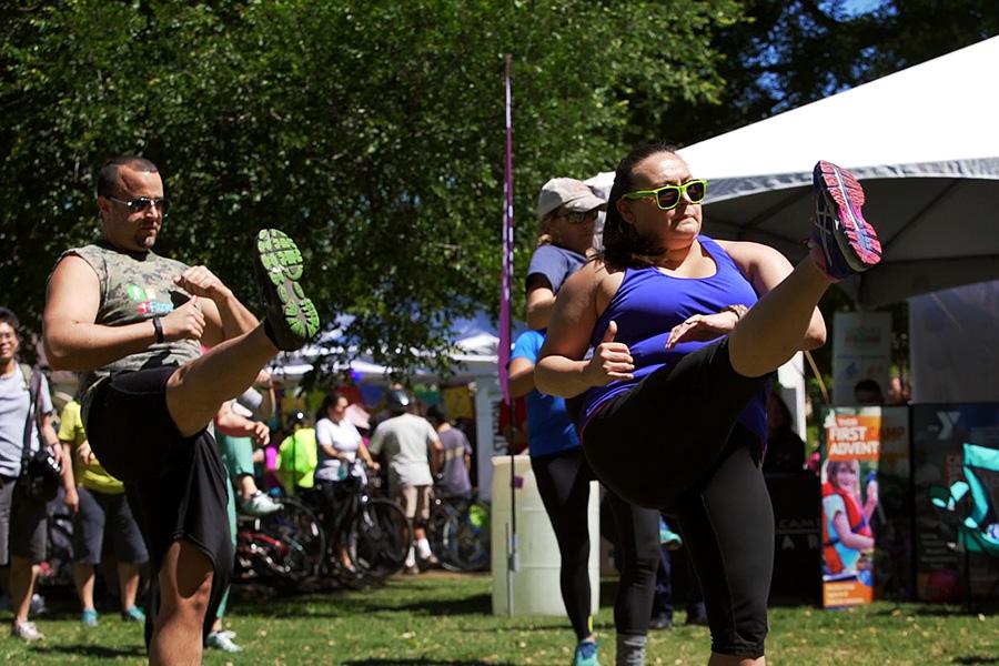 Síclovia participants exercise at Travis park. Photo by Kathryn Boyd-Batstone