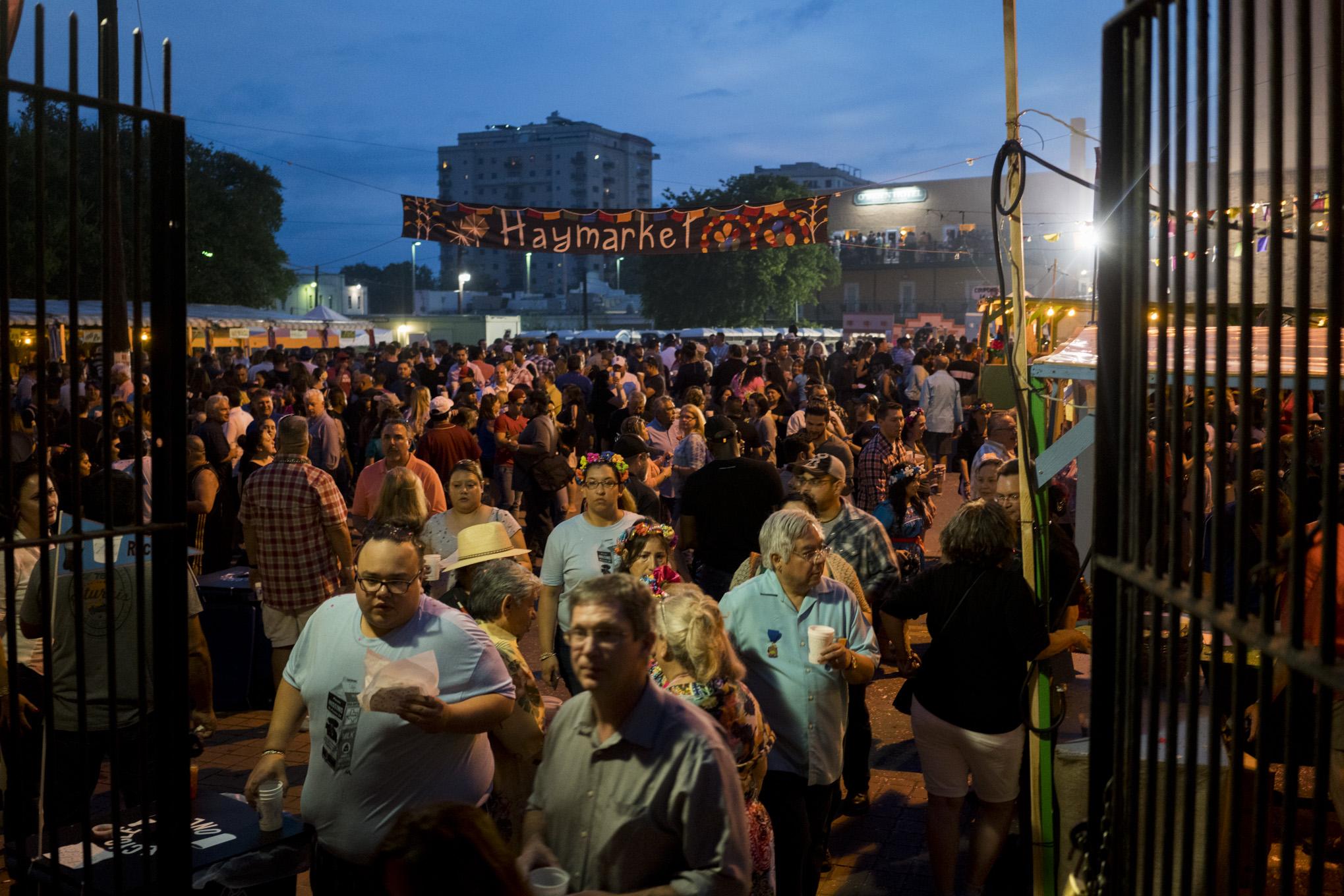 Thousands of people crowd La Villita for NIOSA. Photo by Kathryn Boyd-Batstone