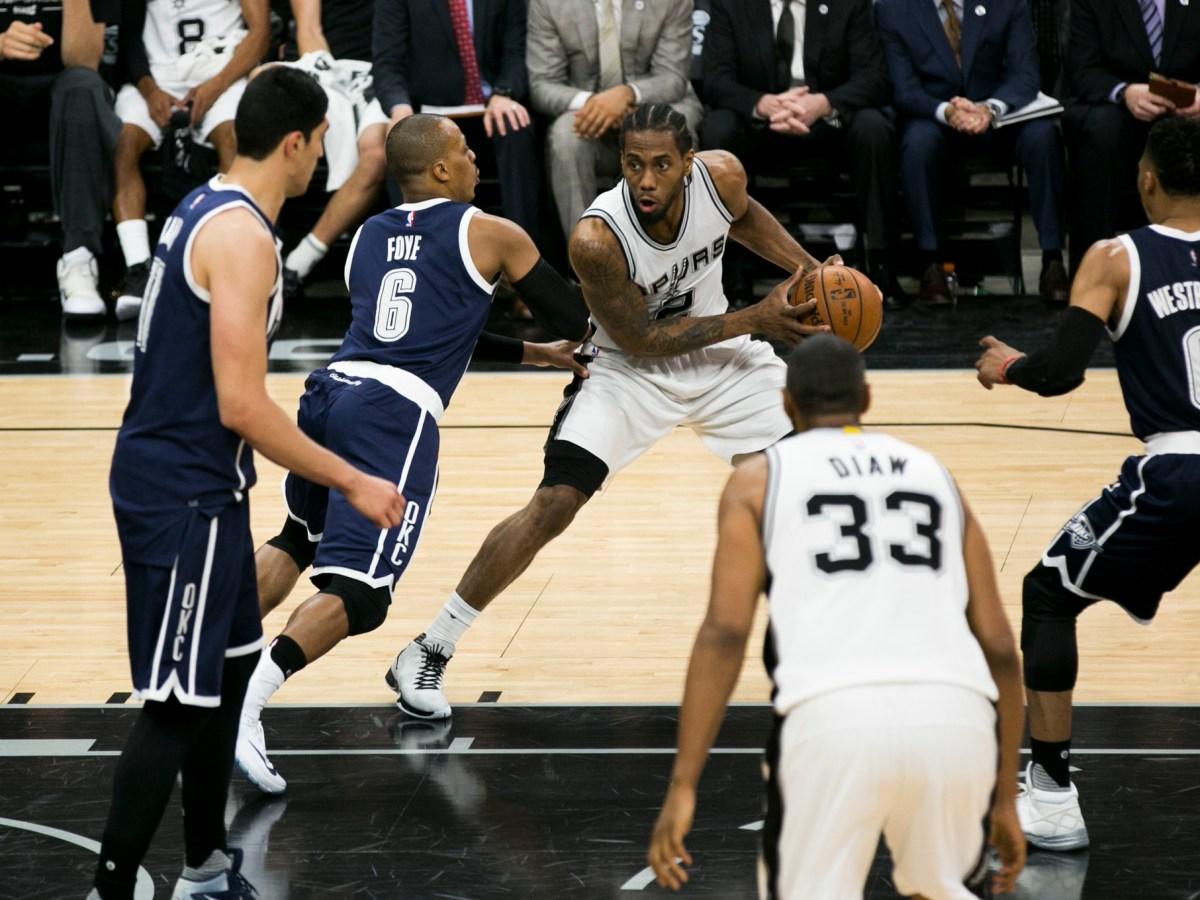 Kawhi Leonard #2 of the Spurs looks to pass. Photo by Kathryn Boyd-Batstone