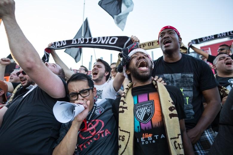 "San Antonio FC fans yell ""San Antonio"" at the start of the game. Photo by Michael Cirlos."