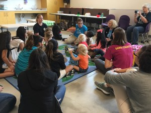 Cheryl Viera, early childhood educator at the DoSeum, leads storytime with pre-schoolers during Week of the Young Child. Photo by Bekah McNeel