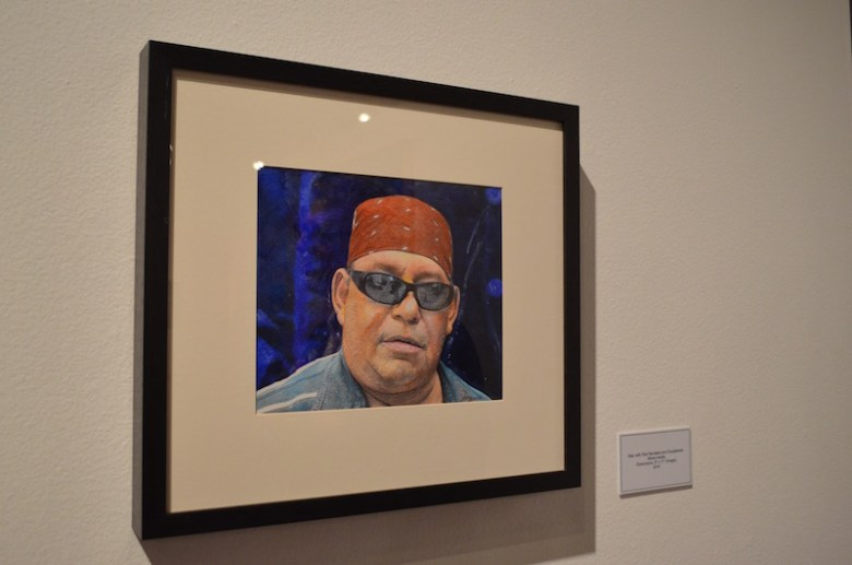 """""""Man with Red Bandanna"""" is artist Mario Garza's version of Jan van Eyck's """"Portrait of a Man in a Red Turban,"""" one of Garza's favorite pieces. Photo by Camille Garcia."""