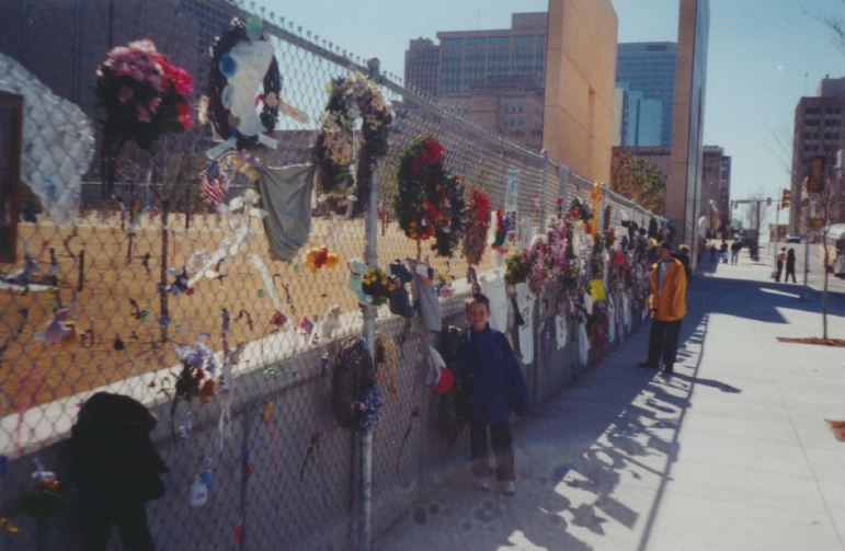 A fence was installed soon after the bombing on April 19, 1995, and visitors began leaving items of remembrance. Photo by Don Mathis.