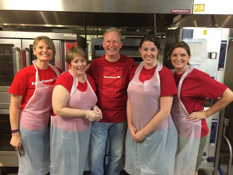 Bank of America employees volunteer in the San Antonio Food Bank kitchen at Haven for Hope, preparing and serving a meal for residents. Photo courtesy of Jennifer Cantu.