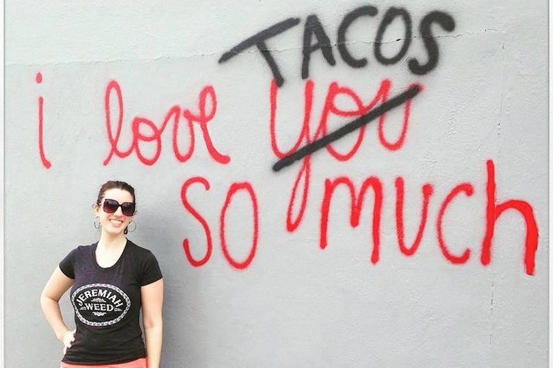 Jillian Reddish at the now-infamous taco wall. Photo courtesy of Jillian Reddish.
