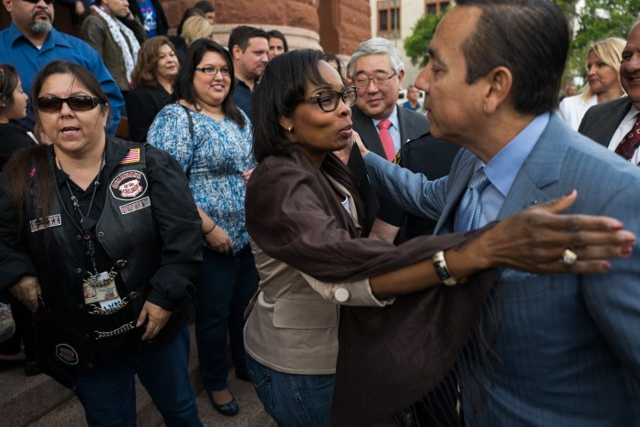 Mayor Ivy Taylor and Texas Senator Carlos Uresti (D19) embrace after the press conference concludes. Photo by Scott Ball.