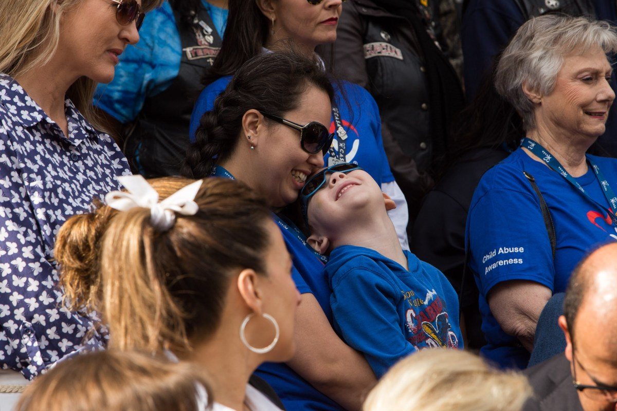 Christina Brockway and Edward, 4, share a moment together during the press conference on the Bexar County Courthouse steps. Photo by Scott Ball.
