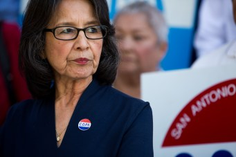 Maria Tijerina stands at a podium moments before a press conference. Photo by Scott Ball.