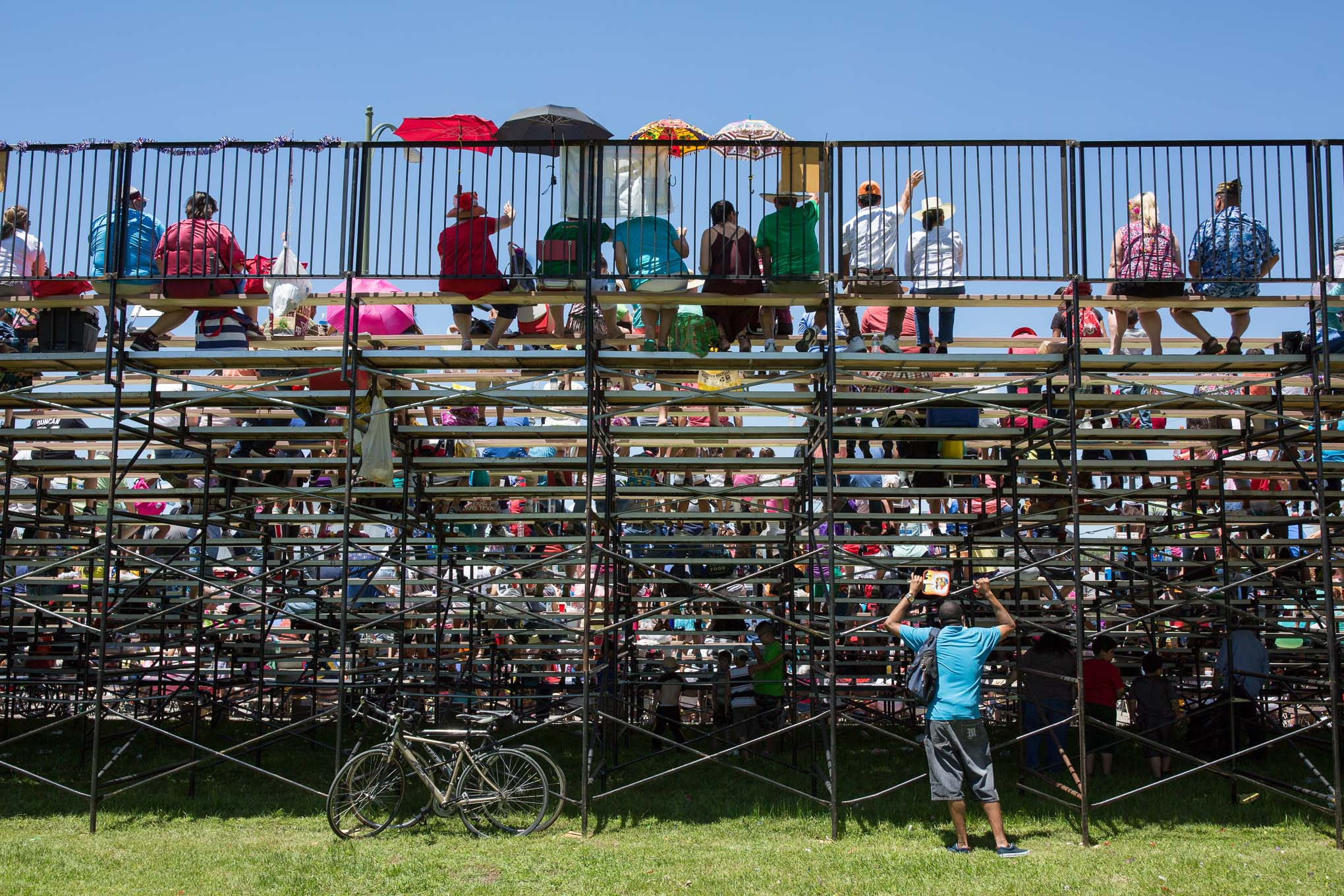 Attendees sit on risers overlooking the parade air Maverick Park. Photo by Scott Ball.