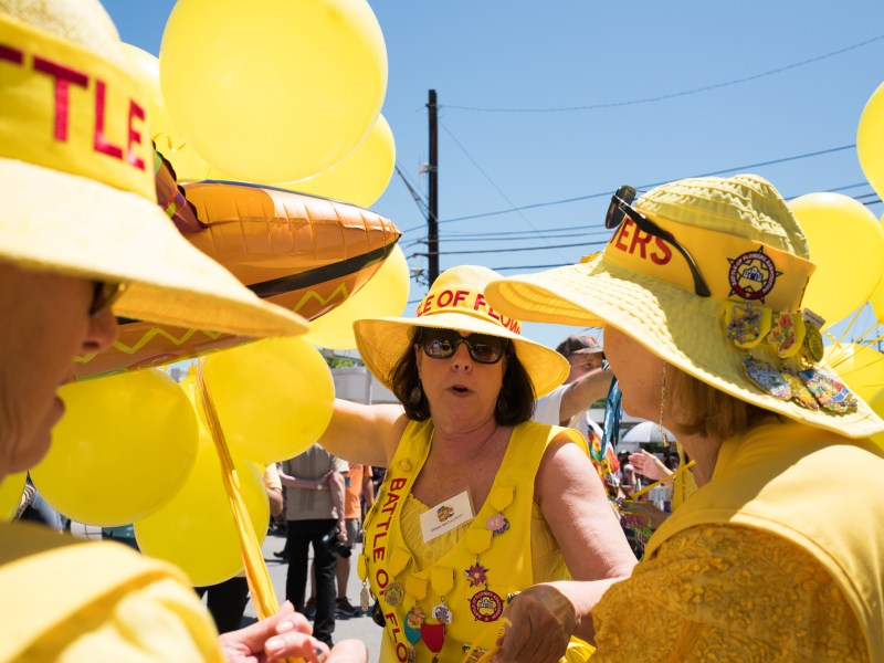 Members of the Battle of Flowers Association hold yellow balloons in preparation to kick off the parade. Photo by Scott Ball.
