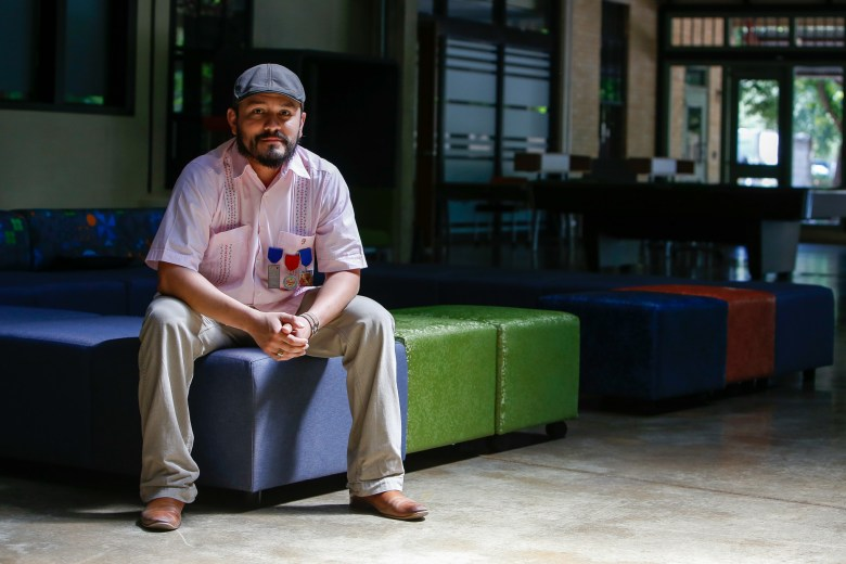 SpaceCadet co-founder Steven Quintanilla sits in a common area at Peer 1 Hosting. Photo by Scott Ball.