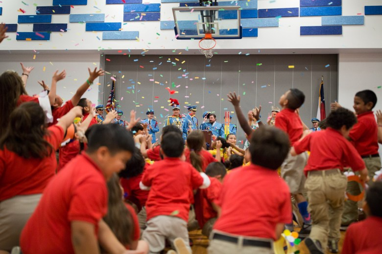 Students jump for confetti as it rains down upon them. Photo by Scott Ball.
