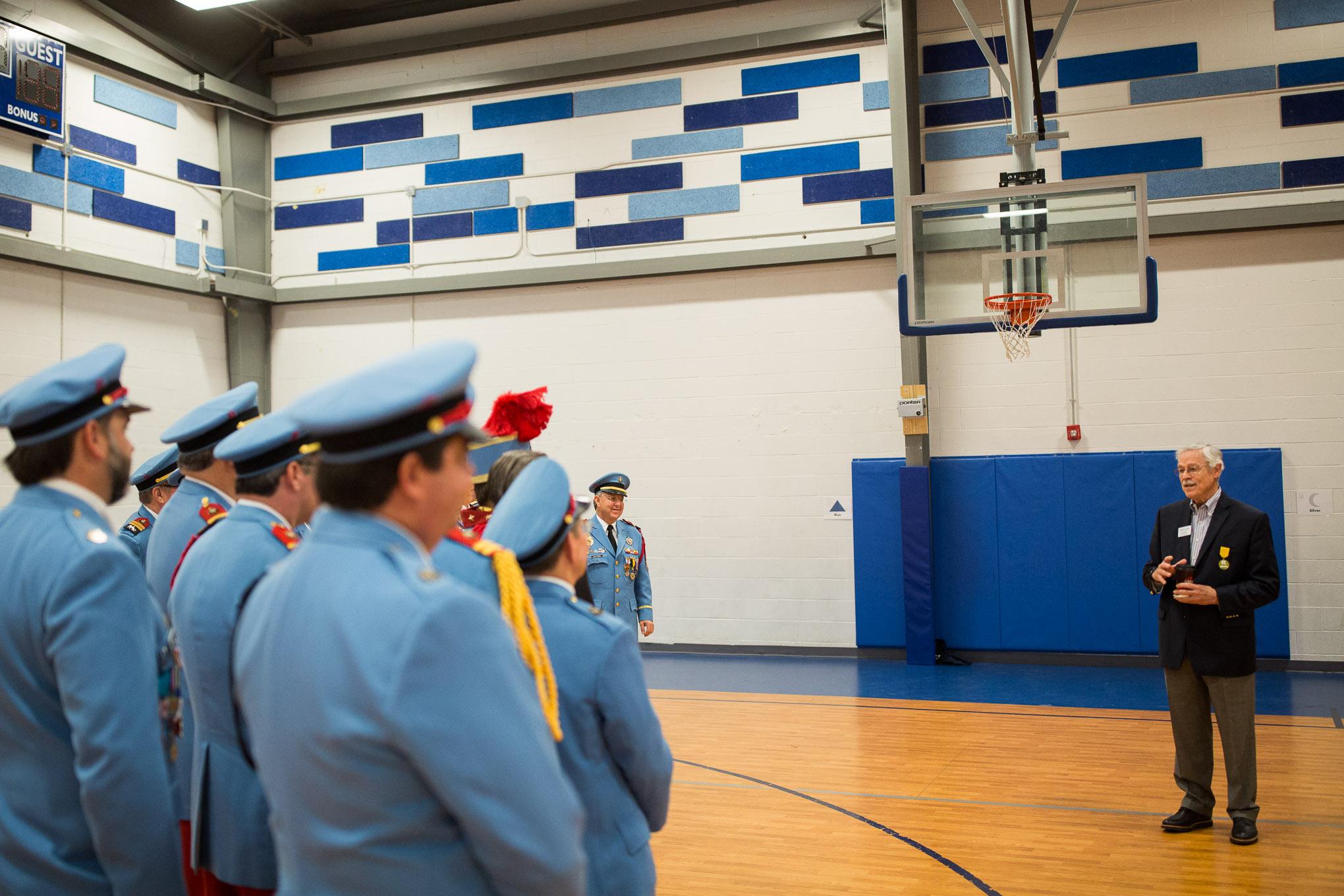 KIPP Board Member Bill Moll shares a thought with Texas Cavaliers in the KIPP San Antonio gymnasium. Photo by Scott Ball.