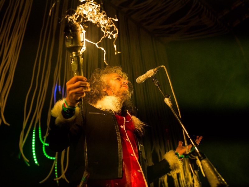 Wayne Coyne pumps up the audience during his performance of Yoshimi Battles the Pink Robots Part. 1. Photo by Scott Ball.