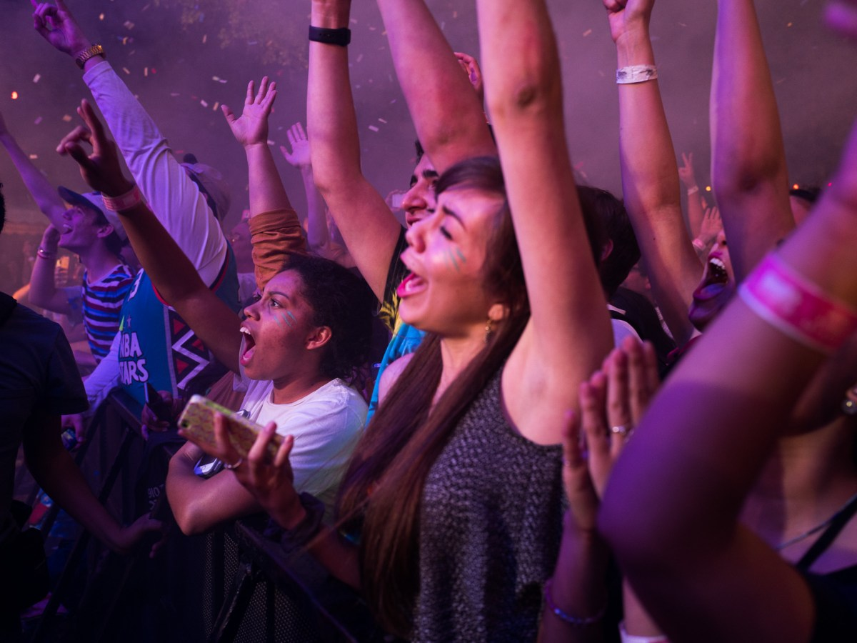 Festival goers scream as they raise their arms to The Flaming Lips song. Photo by Scott Ball.