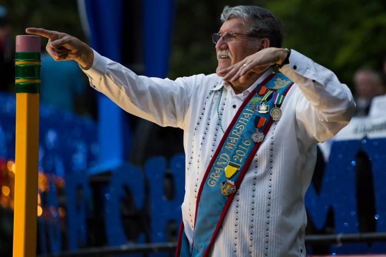 UTSA President and the Texas Cavaliers River Parade Grand Marshal Ricardo Romo points to the crowd. Photo by Scott Ball.