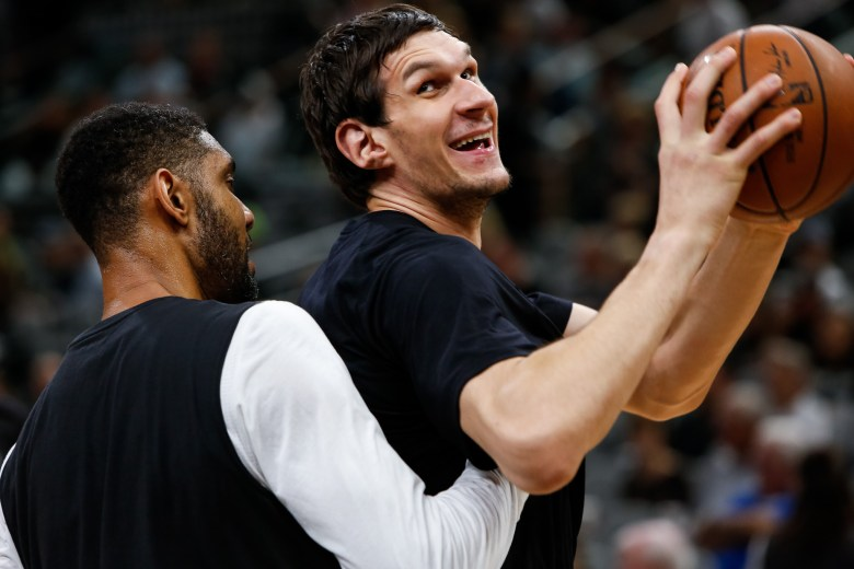 Spurs Centers Tim Duncan and Boban Marjanovic warm up before the game. Photo by Scott Ball.