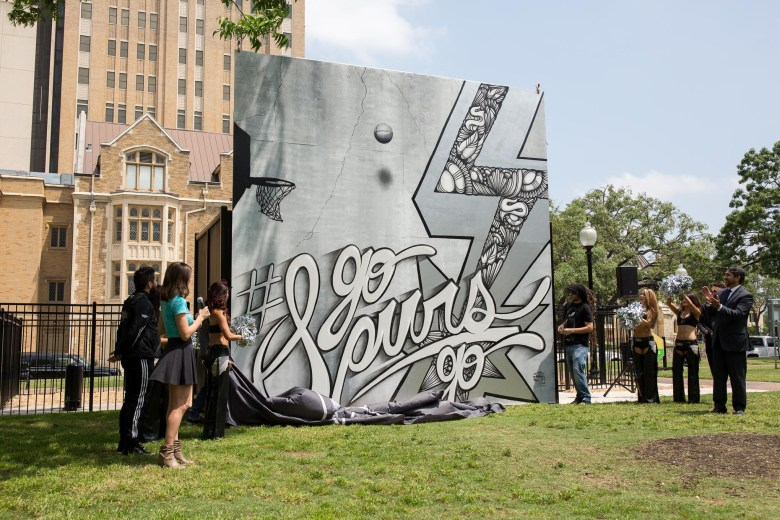The unveiling of a mural painting the town silver and black in honor of the San Antonio Spurs by Shek Vega and Nic Soupé (4/4). Photo by Scott Ball.