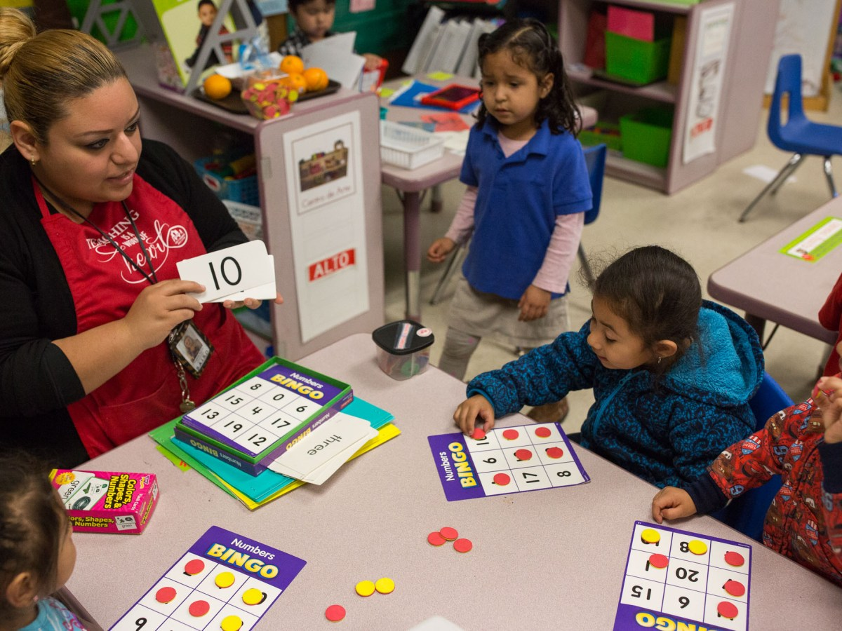 A teacher at Stewart Elementary, which received an Improvement Required rating by the State, works with students in reading class. Photo by Scott Ball.