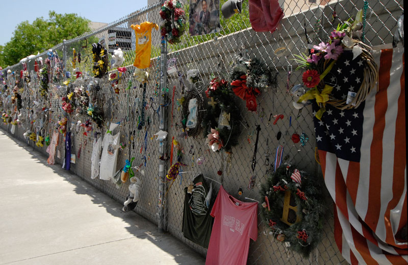 A chain link fence was hastily erected around the bomb site in April 1995 to provide security as rescue workers dug through the rubble. People immediately began to leave flowers, messages, and other expressions of sympathy and concern. The fence will remain as long as people remember. Image courtesy Oklahoma City National Memorial.